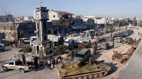 A general view shows soldiers loyal to the Syrian regime with their military tanks in Qusayr, after the Syrian army took control of the city from rebel fighters. Photograph: Mohamed Azakir/Reuters