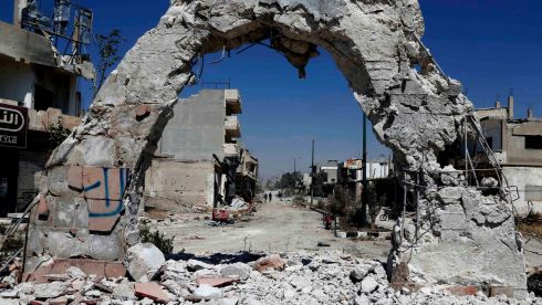 A view of a damaged street filled with debris in Qusayr. The majority of the town's inhabitants appear to have fled over the past year, with the sizeable Christian population taking to the mountain villages of the interior and heterodox Shia Alawites moving to the coast. Photograph: Mohamed Azakir/Reuters
