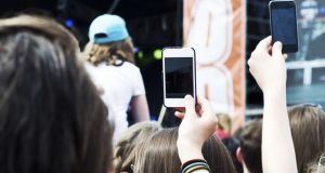 Bad coverage: It used to be lighters in the air at concerts – now it's smartphones. Photograph: Thinkstock
