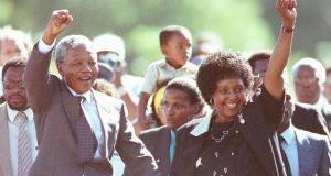 Nelson Mandela and his then wife Winnie saluting well-wishers as he leaves Victor Verster prison, February 11th, 1990. Mandela spent 27 years incarcerated as a political prisoner of South Africa's apartheid regime. Photograph: Ulli Michel/Reuters