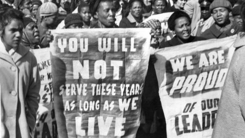African women demonstrate in front of the Law Courts in Pretoria, 16 June 1964, after the verdict of the Rivonia trial, in which eight men, among them anti-apartheid leader and African National Congress (ANC) member Nelson Mandela, were sentenced to life imprisonment. The eight men were accused of conspiracy, sabotage and treason. Photograph: Getty Images
