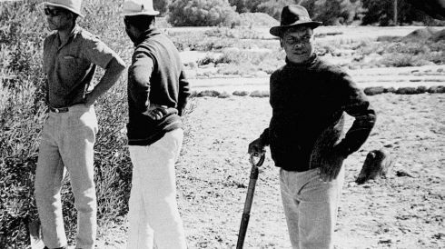 A rare glimpse of Nelson Mandela (left) with hat, spade and dark glasses doing prison work in the garden of Robben Island jail where he spent 18 of his 27 years as a political prisoner. Working alongside him in the picture, taken surreptiously sometime in the 1970s, are Andimba Toivo ja Toivo (centre), who later became Namibian Minister of Mines and Minerals, and Brigadier Justice Mpanza (right), a  former commander in the African National Congress' armed wing. Photographs of Mandela as prisoner were banned by the apartheid government, fearing his status as an African icon.