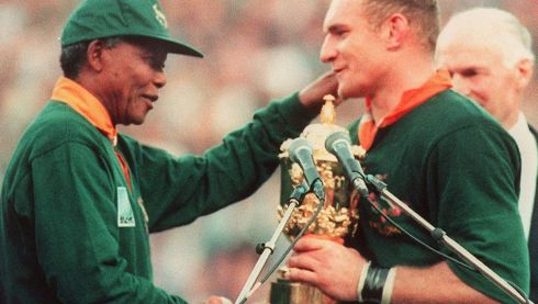 South African rugby team captain, Francois Pienaar (right), is congratulated by South African president Nelson Mandela after South Africa won the Rugby World Cup final against New Zealand 24th June 1995 in Johannesburg. Photograph: Jean-Pierre Muller/Getty Images