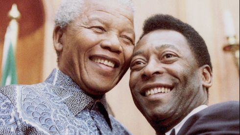 Then South African president Nelson Mandela and the world's most famous footballer Pele smile for photographers in 1995. Photograph: Juda Ngwenya/Reuters