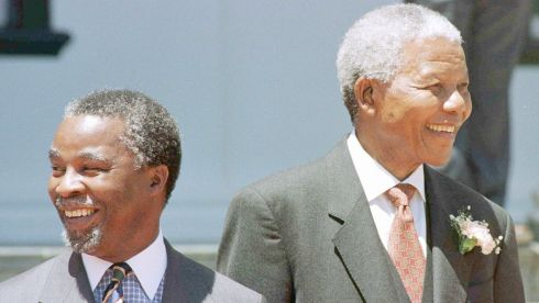 Former presidents of South Africa Nelson Mandela and Thabo Mbeki leave the South African Parliament building after the opening of its first session under the country's new constitution. In his speech Mr Mandela promised further progress on privatisation and the abolition of exchange controls. Photograph: Mike Hutchings/Reuters