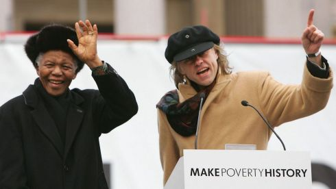 "The former South African president waves to the crowd with musician and campaigner Bob Geldof during a mass rally in Trafalgar Square on February 3rd, 2005 in London, England. Mr Mandela told the rally to help ""Make Poverty History in 2005"" and  help set free millions of people in the world's poorest countries who remained imprisoned by poverty. Photograph: Scott Barbour/Getty Images"