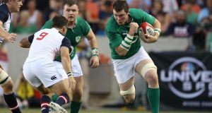 Ireland's Peter O'Mahony runs at USA's Mike Petri. Photograph: Inpho/Billy Stickland
