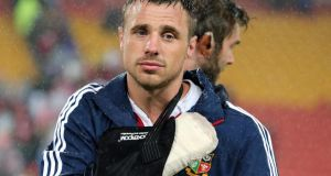 Tommy Bowe looks dejected after suffering a broken hand against the Queensland Reds. Photograph: Dan Sheridan/Inpho