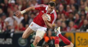 Tommy Bowe of the Lions moves away from Nick Frisby during the match between the Queensland Reds and the British & Irish Lions at Suncorp Stadium. Photograph:  David Rogers/Getty Images