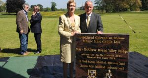 Former president Mary McAleese and her husband, Dr Martin McAleese, pose at the ceremonial stone at the naming ceremony for the Mary McAleese Boyne Valley Bridge at Oldbridge House in Drogheda as Taoiseach Enda Kenny and Sinn Féin president Gerry Adams speak in the background.