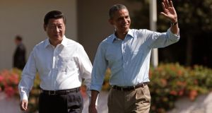 US president Barack Obama and Chinese president Xi Jinping walk the grounds at the Annenberg Retreat at Sunnylands in Rancho Mirage in California on Saturday. Photograph: Reuters/Kevin Lamarque