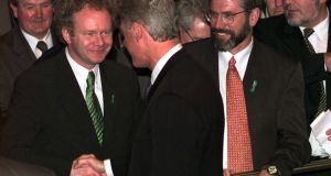 US president Bill Clinton shakes hands with Martin McGuinness (left) while  Sinn Féin leader Gerry Adams watches on in September 1998. Photograph: AP