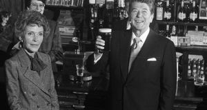 US President Ronald Reagan drinks a pint of Guinness in the Ronald Reagan pub in Ballyporeen, Co Tippeary, in 1984, accompanied by his wife Nancy. Photograph: Pat Langan