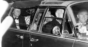 President Kennedy and his female entourage en route to a State function