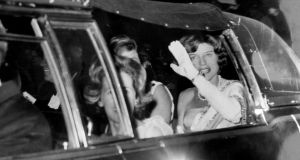 President Kennedy and his female entourage en route to a State function.