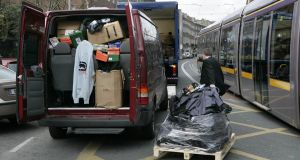 Counterfeit clothing, shoes and DVDs are taken away from Harcourt Street after they were seized by the Criminal Assets Bureau in 2008. Photograph: Dara Mac Dónaill/The Irish Times