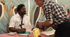 Ben Okri autographs his work