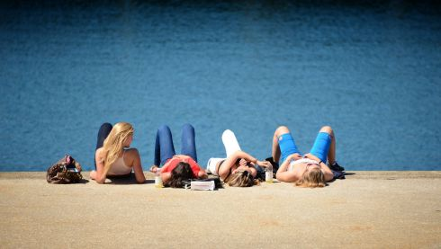 Enjoying the sun on the East Pier in Dun Laoghaire, Dublin. Photograph : David Sleator/The Irish Times