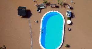 A garden with a swimming pool is inundated by the waters of the Elbe river during floods near Magdeburg in Saxony-Anhalt. Photograph: Thomas Peter/Reuters
