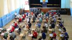 Pupils of Marian College Sandymount commence their english exam in the school's sports hall last week. Photograph: Bryan O'Brien/The Irish Times