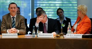 German  minister for defenceThomas De Maiziere (centre) at a recent committee of enquiry  on the Euro Hawk unmanned surveillance drone programme. Photograph: Reuters