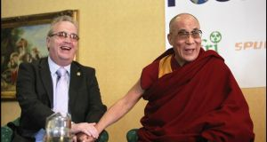 Richard Moore, who was blinded by a rubber bullet, with the Dalai lama