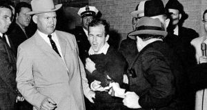 President Kennedy's assassin Lee Harvey Oswald is fatally shot by nightclub owner Jack Ruby.