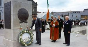 John F Kennedy lays a wreath at the statue of Commodore John Barry, with mayor of Wexford Thomas Byrne, minister of external affairs Frank Aiken and US ambassador to Ireland Matthew McCloskey