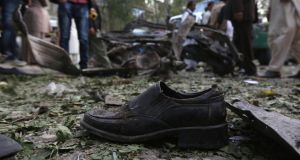 The shoe of one of the victims of the suicide car bomb attack in Kabul yesterday. Photograph: Omar Sobhani/Reuters