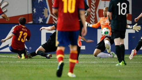 Juan Mata adds Spain's  second, guiding the ball past the depairing dive of Ireland's goalkeeper Darren Randolph