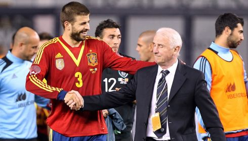 Spain's Gerard Pique shakes hands with Ireland's manager Giovanni Trapattoni after the friendly ended 2-0 for Spain