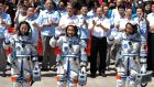 Chinese astronauts (from left): Wang Yaping, Zhang Xiaoguang and Nie Haisheng, wave before leaving for the Shenzhou-10 manned spacecraft mission at Jiuquan satellite launch centre inJiuquan, Gansu province, on Tuesday. Photograph: Reuters/China Daily