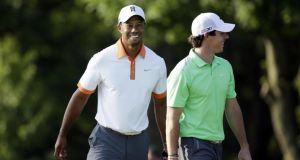 Tiger Woods and Rory McIlroy enjoying their practice round at Merion yesterday.