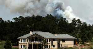 Smoke billows near a home from the Black Forest Fire  north of Colorado Springs, Colorado. Photograph:  Chris Schneider/Getty Images