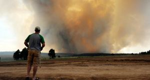 Shad Dohl, of Colorado Springs watches as smoke rises into the air from the Black Forest Fire  near Colorado Springs, Colorado yesterday.  Photograph: Chris Schneider/Getty Images