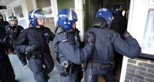 Metropolitan Police officers carry out a raid on a property on the Churchill Gardens estate in Pimlico nearly 5,000 officers must be brought in between now and 2017 just to keep the force's numbers steady because of retirements. Photograph: Getty