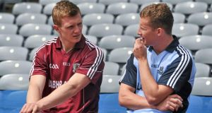 Joe Canning (left) and Dublin dual player Ciarán Kilkenny in Croker yesterday to launch a GAA initiative to support the Irish language. Photograph: Barry Cregg/Sportsfile