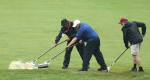 Grounds crew workers remove water from the second fairway during a weather delay on the first round of the 2013 U.S. Open golf championship at the Merion Golf Club in Ardmore, Pennsylvania. Photograph: Reuter/Adam Hunger