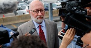 "JW Carney, defense attorney for accused mob boss James ""Whitey"" Bulger, talks to reporters as he arrives at the US Federal Courthouse for the start of Bulger's trial in Boston, Massachusetts. Photograph: Reuters"