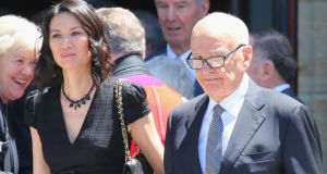 Rupert Murdoch has filed for divorce from his wife Wendi Deng (left). Photograph: Getty