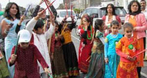 Savita Halappanavar (left of photo) with children at Galway's St Patrick's day parade.
