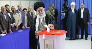 Iran's supreme leader Ayatollah Ali Khamenei casts his ballot at his office during the Iranian presidential election in central Tehran today. Photograph: Fars News/Hassan Mousavi/Reuters