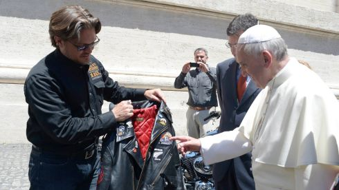 Pope Francis is presented with a leather Harley Davidson jacket during an audience in Saint Peter's Square at the Vatican, ahead of the weekend blessing.  Photograph: Osservatore Romano/Reuters
