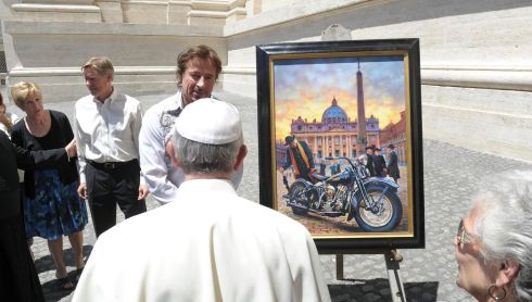 Pope Francis is presented with a painting of a Harley. Photograph: Osservatore Romano/Reuters