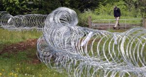 Razor wire is laid in fields near Lough Erne Hotel resort in Co Fermanagh, venue for next weeks G8 summit. PRESS ASSOCIATION Photo. Picture date: Wednesday June 12, 2013. See PA story POLITICS G8 Security. Photo credit should read: Paul Faith/PA Wire