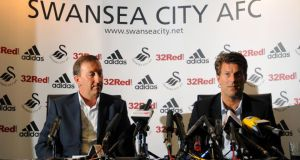Swansea City manager Michael Laudrup (right)  and chairman Huw Jenkins are not in dispute, according to the Dane's agent. Photograph:  Andy Lloyd/PA Wire