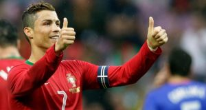 Portugal captain Cristiano Ronaldo says he has not signed new Real Madrid deal. Photograph: Denis Balibouse/Reuters