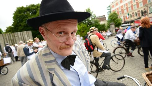 Paul Kennedy gets up as James Joyce himself in Edwardian costume for the 20th annual Brennans Bread Bloomsday Messenger Bike Rally, in aid of the Irish Youth Foundation, on Dublins St Stephen's Green. Photograph: Alan Betson/The Irish Times