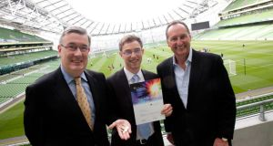 From left: Kieran McLoughlin, president and CEO of the Worldwide Ireland Funds, Lukas Decker of Coindrum, Ireland Funds Business Plan competition winner 2012, and Bill McKiernan, chair of the judging panel and co-founder of CyberSource, at the Aviva Stadium