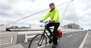 Losing time: Colm Keena on Samuel Beckett Bridge, in Dublin. Photograph: Dara Mac Dónaill/The Irish Times